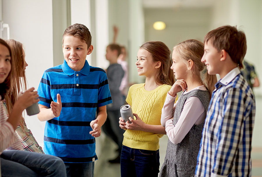 Boy confidently telling a story to group of preteens